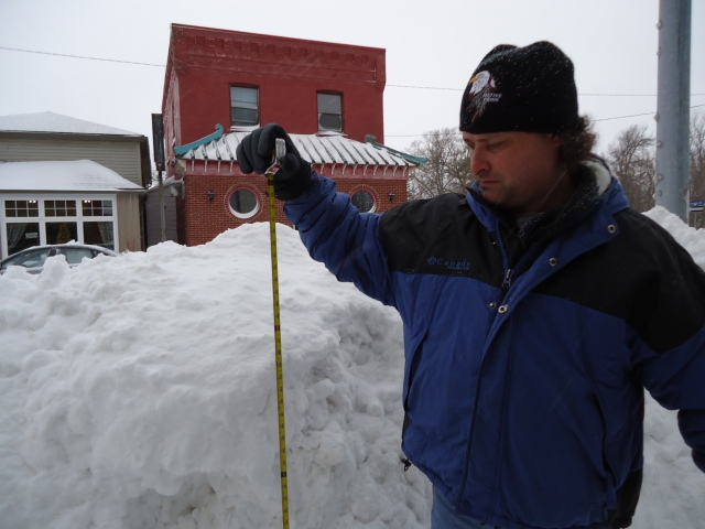 harry holds measuring tape 56.5 inch high snow drift niagara pkwy happy jacks sidewalk fort erie linda randall dec 27 2012