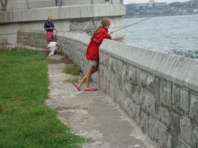 little girl with dad fishing by peace bridge fort erie 22 aug 2013 linda randall