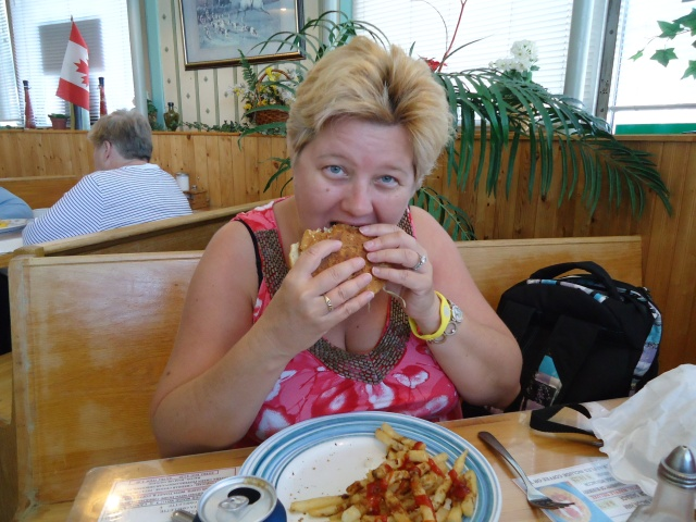 the idea girl linda randall enjoys a chicken burger fries lunch special royal town diner jarvis st fort erie ontario 27 sept 2013