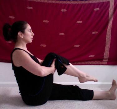 Sivananda Knee Bending (Janu Naman) gentle knee bending pose strengthens muscles bend knee to chest keeping other leg extended n flexed the idea girl says