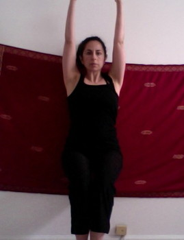 Supported chair pose Utkatasana yoga posture physiotherapeutic exercise wall squat strengthen knee the idea girl says