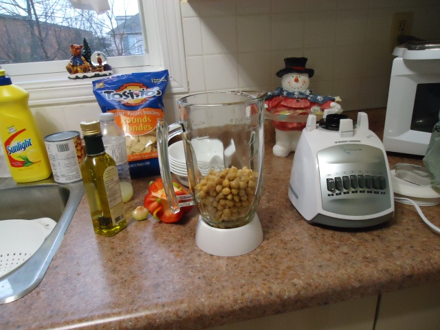 chick peas in blender with roasted red pepper ingredients olive oil lemon juice water