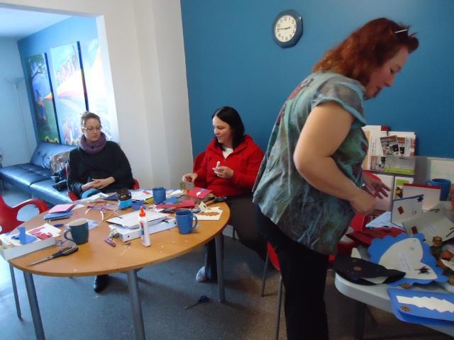 ashley tina debbie working on christmas card crafts community house 16 dec 2013 linda randall