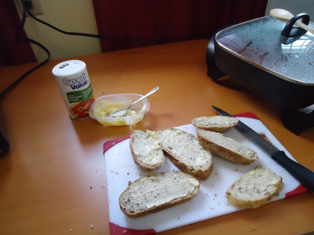 buttered bread with great value pharmesan cheese (walmart) delcious!