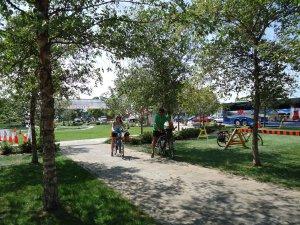 2-cyclists-cross-finish-line-1236-pm-great-waterfront-trail-adventure-2013-linda-randall