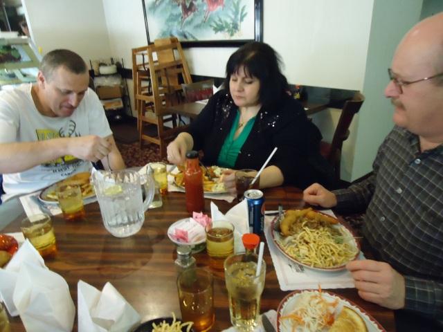 dan linda george eating food interior happy jacks chinese  american food restaurant niagara blvd fort erie on canada linda randall